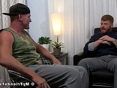 Inked ginger jerks off while his feet worshiped by homo