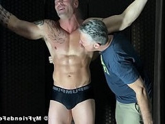 Restrained hunk must endure relentless tickle torment